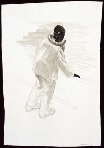 An image of a man with his back toward the viewer.