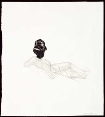 An image of a reclining woman with her back toward the viewer.