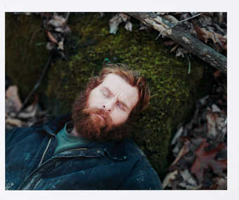 [red bearded man on moss]