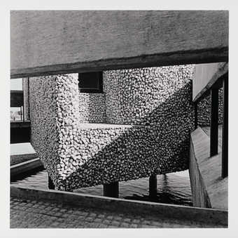 A black and white image of an exterior staircase on a modernist Indian building.