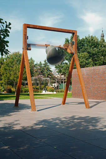 An I-beam construction that supports a bronze bell.  The bell swings every hour, but doesn't...
