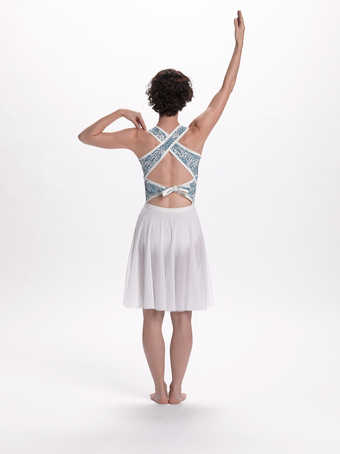 COSTUMES: Short dresses with white micro mesh skirts and blue/white patterned tops. Women have...