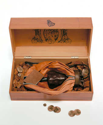 A wooden box containing a leather bound book that explains the project, a zippered