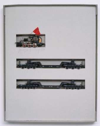 Toy trains in cardboard box.  Multiple originating from action during the art fair IKI ...