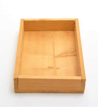 Stapled wooden box with pencilled line and handwritten additions