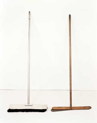 Wooden broom with silver casing, and copper broom handle and head, with felt underlay.  Both...