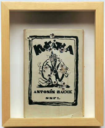 A handbound copy of &amp;quot;Kuktca&amp;quot; by Antonin Macek with 17 holes in it (all holes may not...