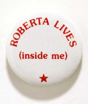 Metal button , white with red lettering that reads, &quot;ROBERTA LIVES/ (inside me).