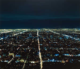 An aerial view of a portion of Los Angeles at night.