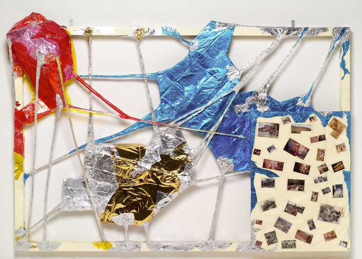 A painted wooden frame spanned and crisscrossed with plastic, aluminum foil and clear adhesive...