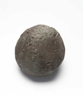 gray ball of plasticine with debris from being rolled on the ground; approximately 200 lbs.;...