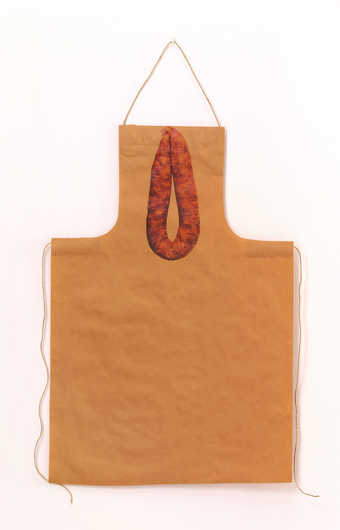 An apron made from brown wrapping paper with iron-on image of a sausage, comes with a recipe for...