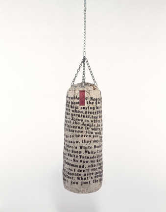 "Punching bag covered with text by Muhammad Ali.  Text reads:  ""Everything that the so-called..."
