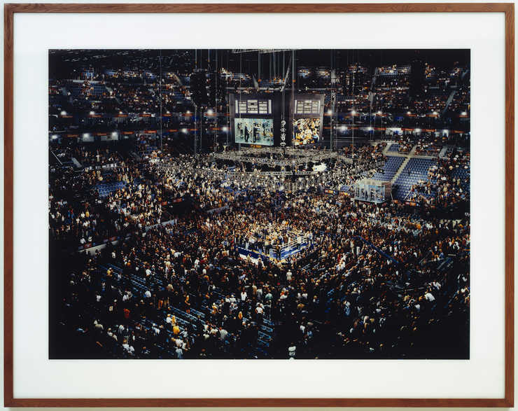 An image of an arena following a boxing match.  One of the fighters is presumably Klitschko, one...