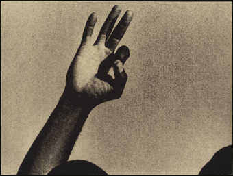 Black and white images of hands touching people on various body parts