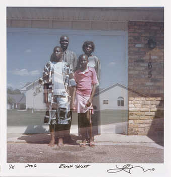 A double exposure type image of a family of four and a suburban house.