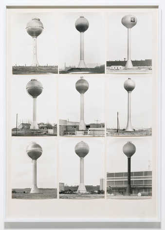 nine black-and-white images of watertowers mounted on white paperboard