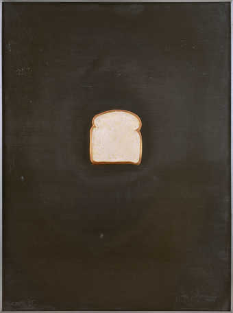 An image of a slice of bread on a sheet of lead.