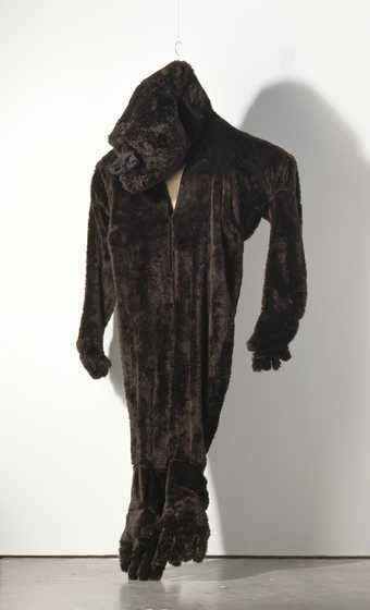 gorilla suit which hangs so that its heels are flat on the ground; this was used in...