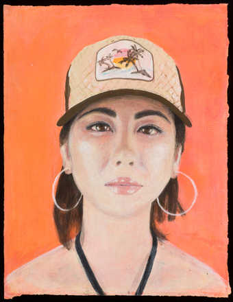 An image of a woman wearing a baseball cap and large hoop earrings.
