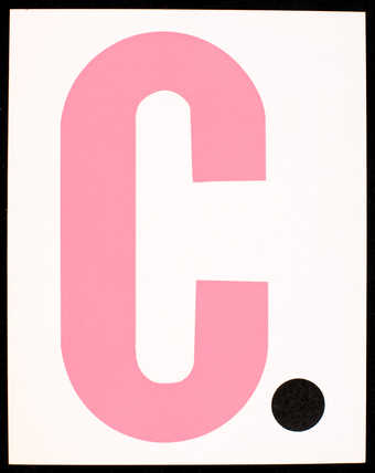 Pink and black print on white card stock; text is in Spanish. Printed both sides. Front has large...
