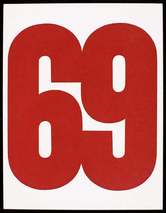 "Red print on white card stock; text is in Spanish. Front has large red ""69."""