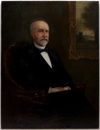 Naturalistic portrait of T.B. Walker sitting posed in a chair, which has bird motif arms, in...