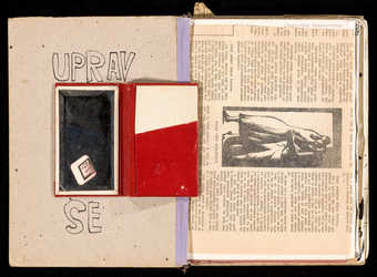 An artist's book with paperboard cover.  Contains: photographs, mirror, map of Prague,...