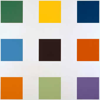 A 3 x 3 grid composed of colored squares; green, yellow, dark blue, blue,, black, red, orange,...