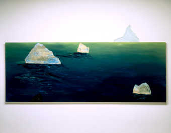sea with boat and icebergs, small  glass attachment on top edge represents tip of iceberg